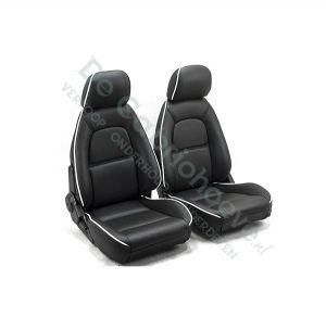 Leren bekleding (zwart met witte bies) voor set stoelen