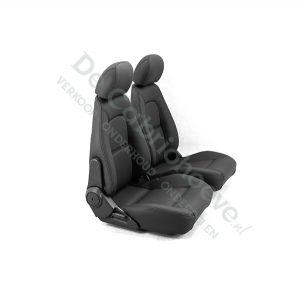 Set geperforeerde lederen stoelen (zwart met wit stiksel) gemonteerd op stoel